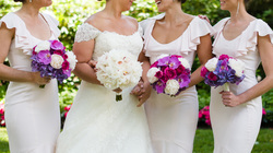 HEPATICA wedding florals (bouquets in pink and purple w/ peony, phalaenopsis orchid, hydrangea & spray roses) – photo: MichaelWill Photographers