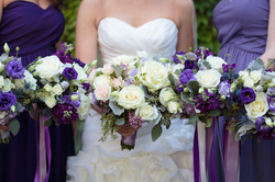 HEPATICA wedding florals (bouquets in white and purple w/ roses, freesia, dusty miller, lisianthus & eryngium) – photo: Dena Galie Weddings