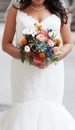 HEPATICA wedding florals (bouquet in coral and blue w/ roses, freesia, safflower, succulents, eryngium & brunia)  – photo: Elizabeth Craig Photography