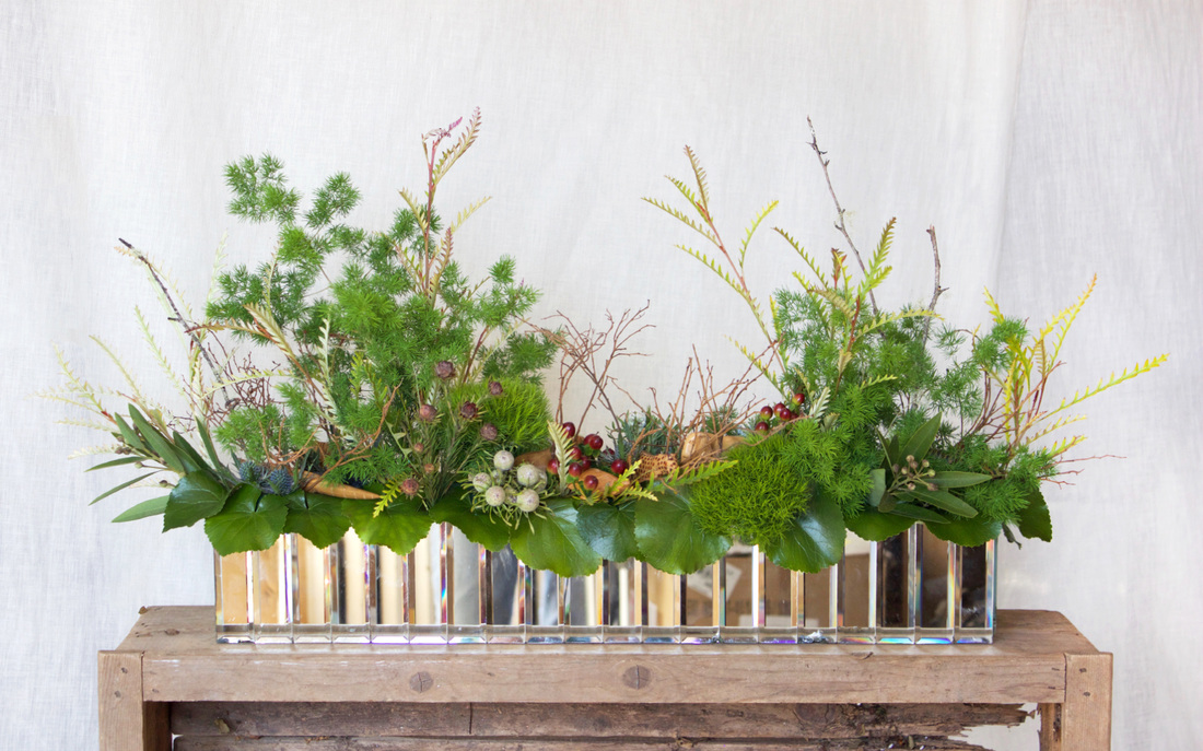HEPATICA table centerpiece (fanciful forest scape, w/ greens, hypericum berry, and wooden jungle animals) – photo: QUARTER design studio